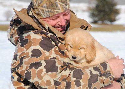 Puppy cuddles in snow